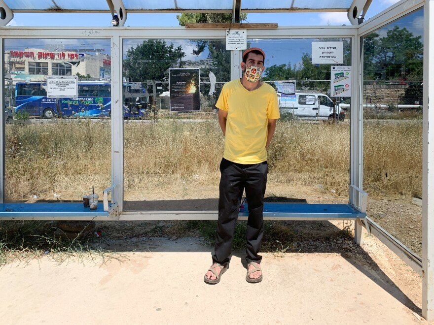 David Deutsch, 33, at a West Bank settler bus stop, on his way to a religious shrine to pray for President Trump to rescind his plan for Israel to annex about 30% of the West Bank and leave the rest for potential Palestinian control.