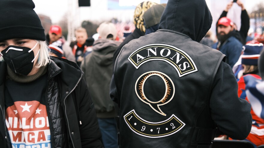 "A QAnon supporter attends the Jan. 6 ""Stop the Steal"" rally in Washington, D.C., after which supporters of former President Donald Trump stormed the U.S. Capitol."