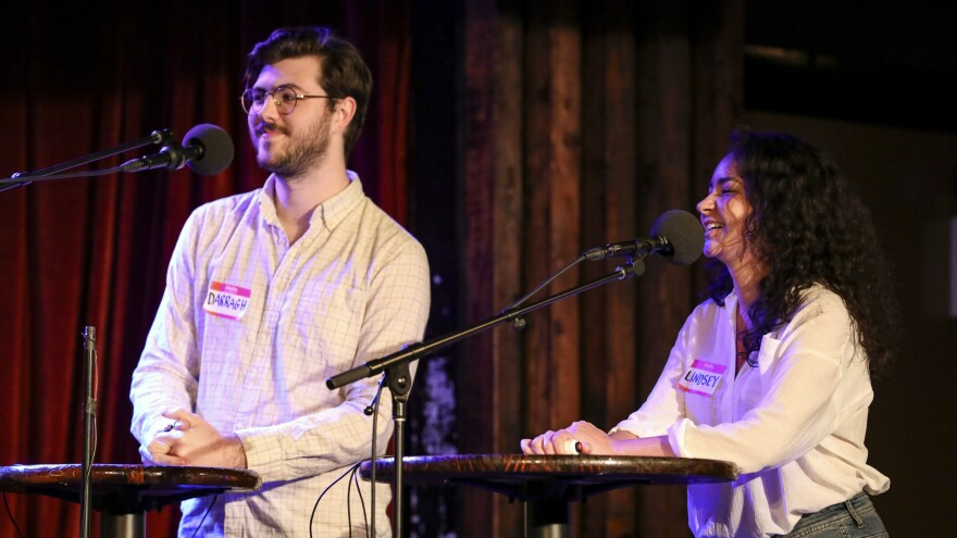 Contestants Darragh Nolan and Lindsay Martinez compete on Ask Me Another at the Bell House in Brooklyn, New York.