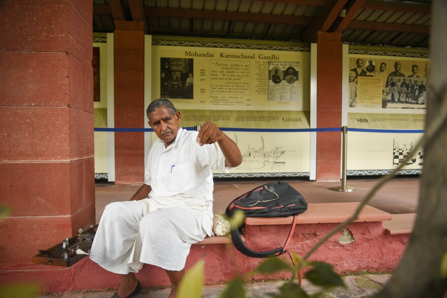 For an hour a week, Musaddilal Gupta, 76, visits the garden where Gandhi died and spins his own thread on a spinning wheel, as Gandhi taught.