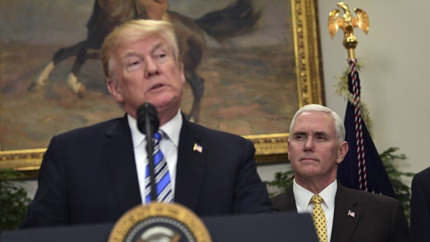 Vice President Pence listens as President Trump speaks at the Thursday event at which Trump signed the orders on steel imports and the other on aluminum imports.