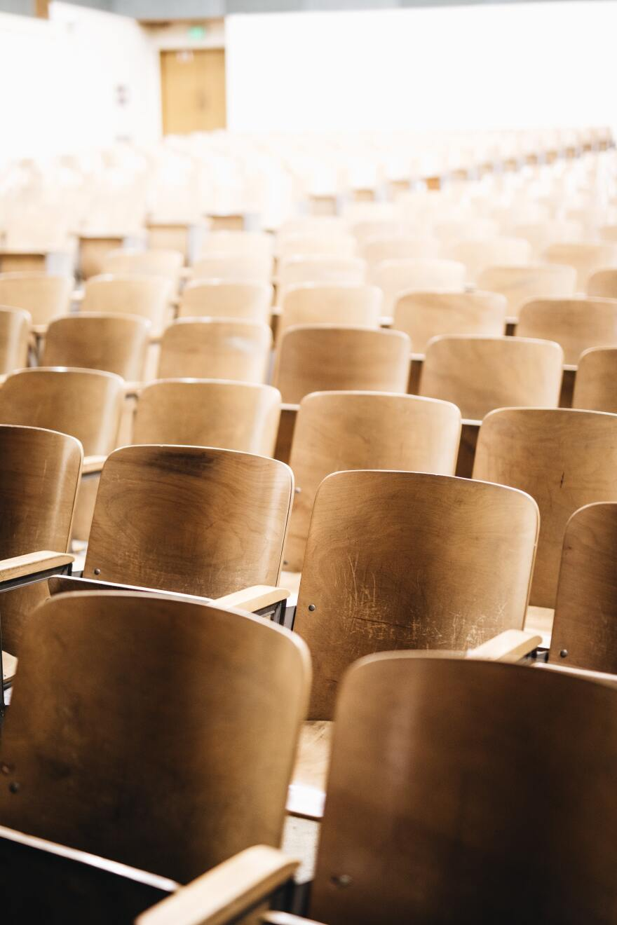 A college lecture hall with empty chairs