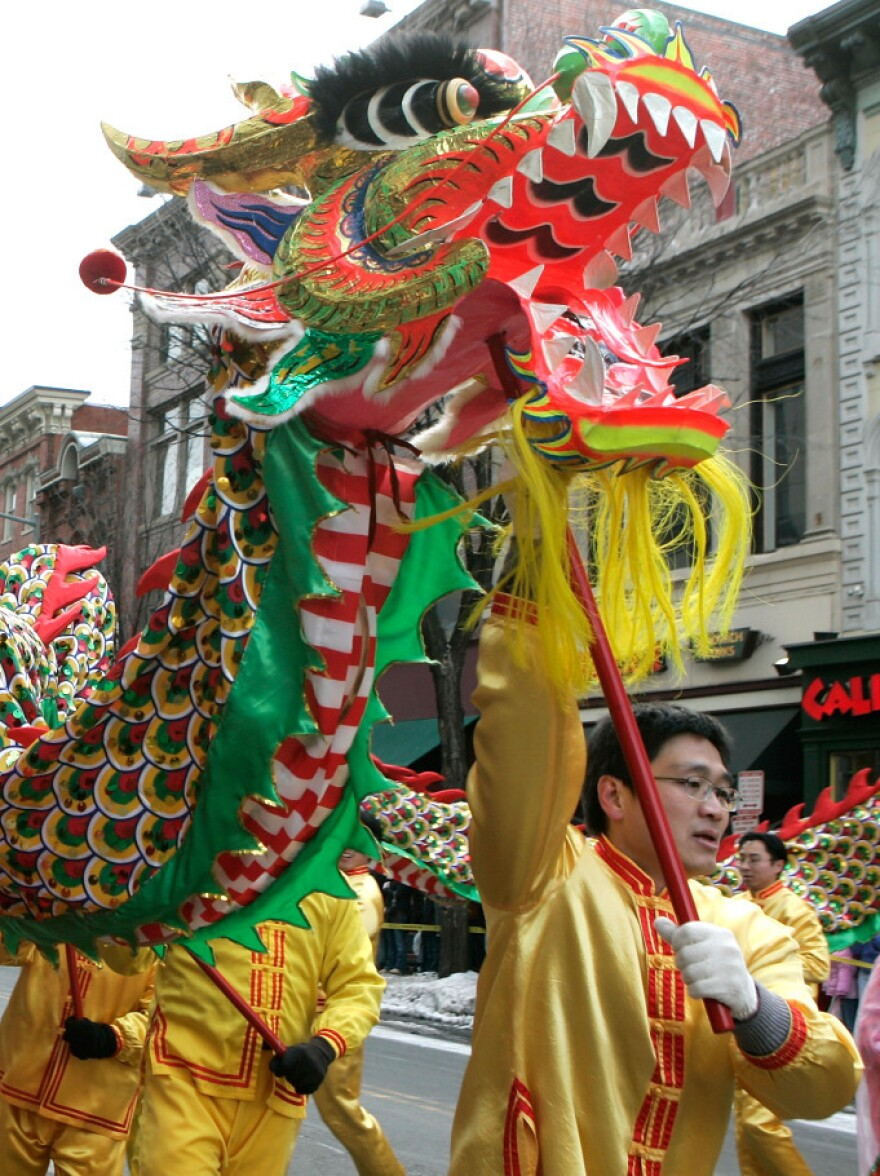 Participants perform a dragon dance during the annual Chinese New Year parade in 2007 in the Chinatown section of Washington, D.C.