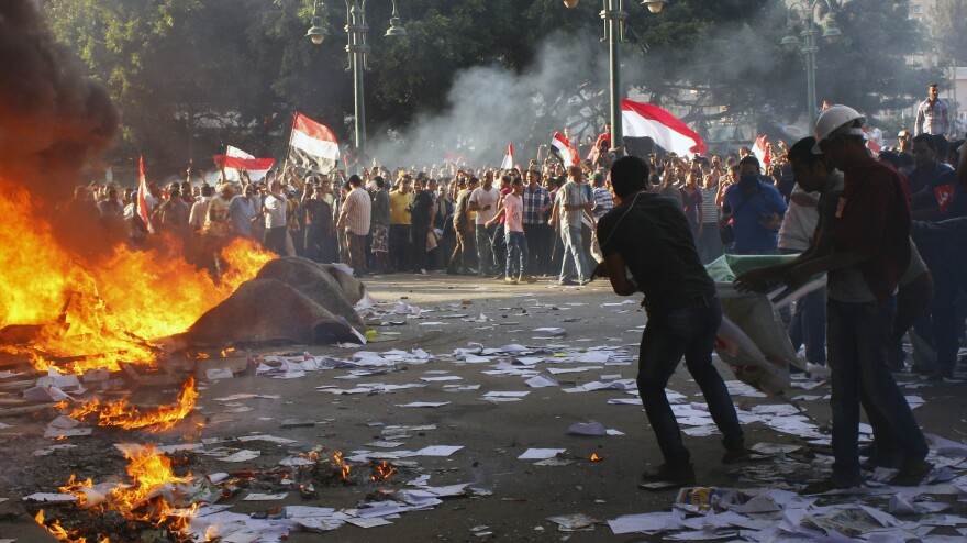 Opponents of Egyptian President Mohammed Morsi took to the streets of Alexandria on Friday. Three people, including one American, were killed during the protest.