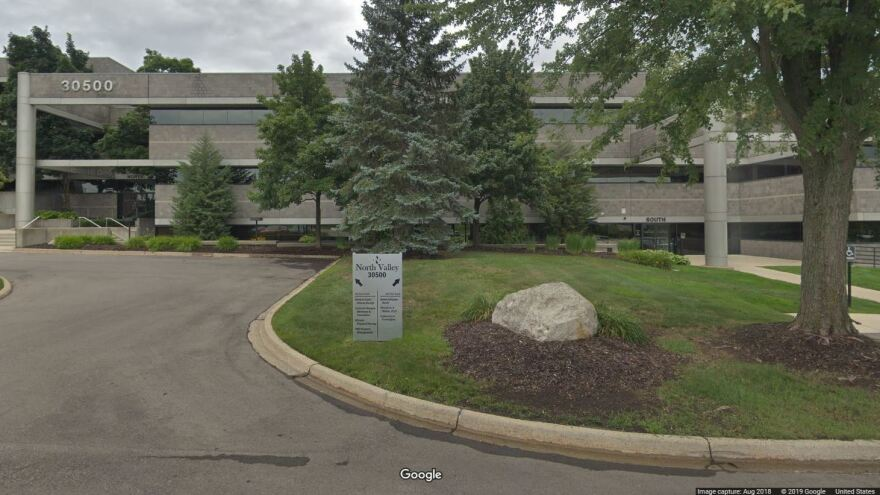 "The ""University of Farmington"" occupied office space in this building in Farmington Hills, Mich. In court documents, eight men are accused of recruiting hundreds of ""students"" to the bogus school."