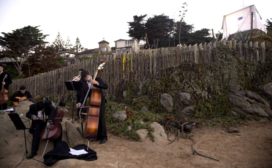 Musicians play Chilean music during the exhumation of the remains of Chilean poet Pablo Neruda in Isla Negra in April. Officials say that tests show Neruda was not poisoned.
