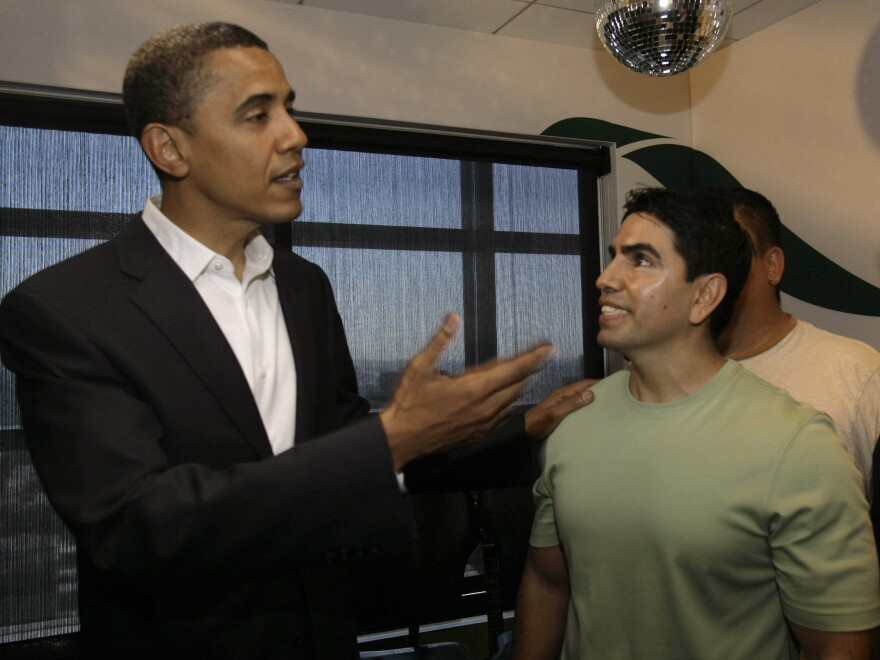 Sotelo chats with then-Senator Barack Obama in 2007 after an interview on his radio show <em>Piolín por la Mañana</em>.