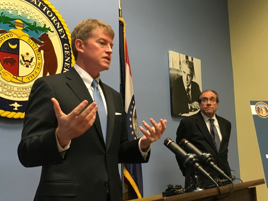 Attorney General Chris Koster speaks a press conference Thursday in St. Louis with Legal Services of Eastern Missouri's Dan Glaizer.