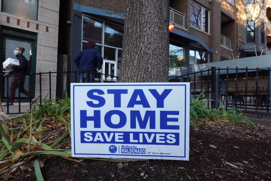 After another week including single-day coronavirus case record, this sign in the Wicker Park neighborhood encourages people to stay home in Chicago, Illinois.