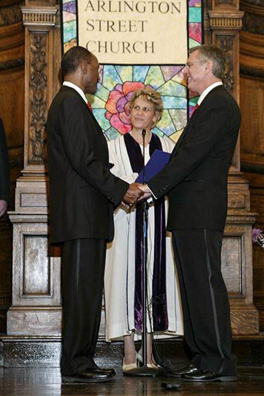 David Wilson (left) and Robert Compton with officiant Rev. Kim K. Crawford Harvie on the couple's wedding day, May 17, 2004, in Boston, Mass.