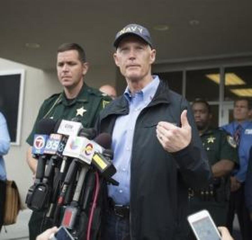 Gov. Rick Scott (right) and Gilchrist County Sheriff Robert Schultz (left) talking to reporters in Bell, Fla. on Friday, Sept. 19, 2014 regarding the Thursday shooting.