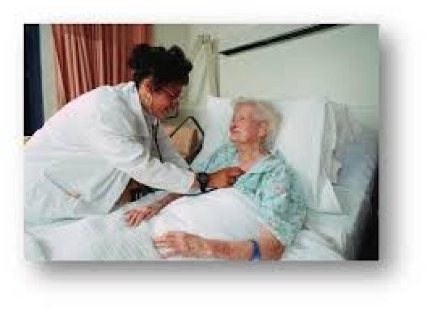 a nurse checks the heart of an elderly patient