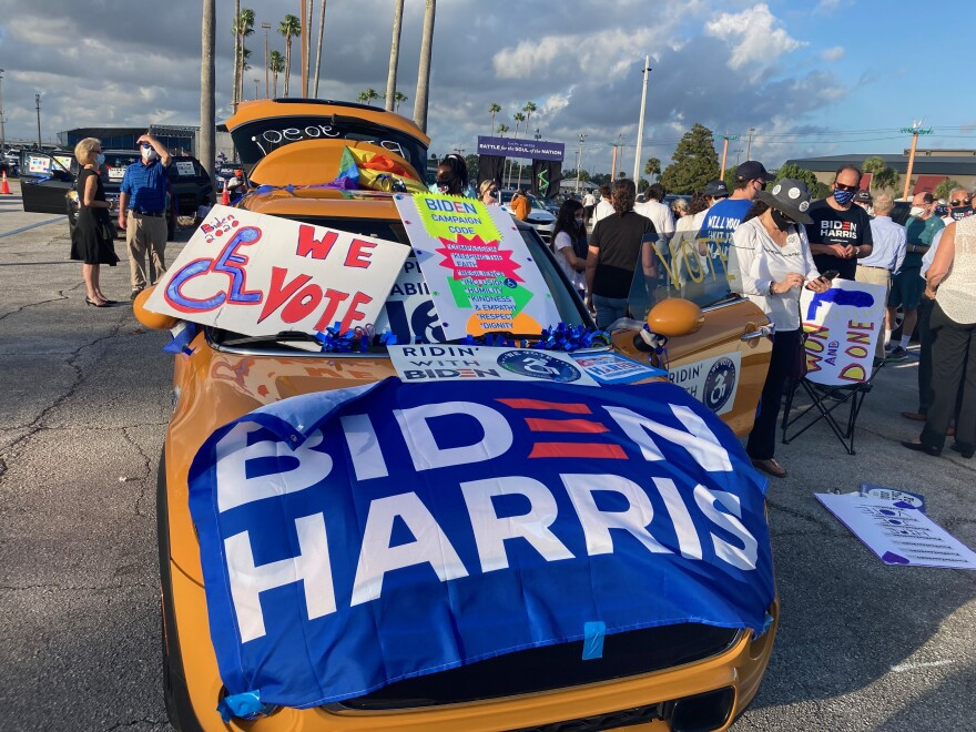 Car covered with political posters