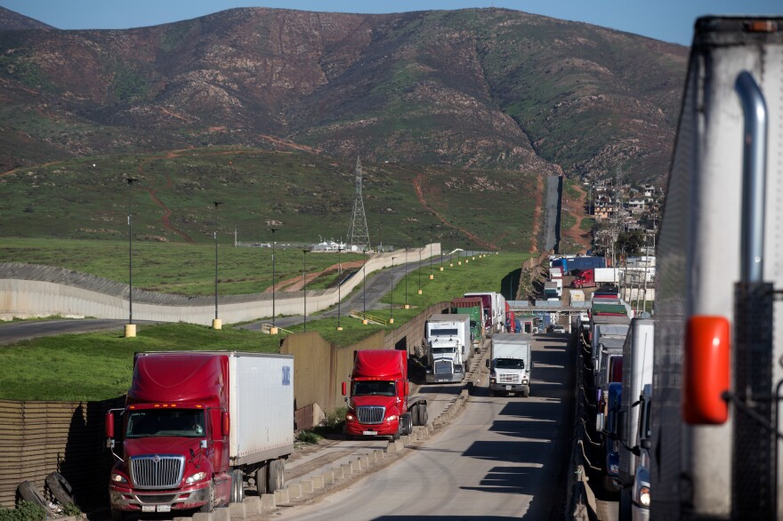 Trucks line up to cross to the United States near the Otay Commercial port of entry on the Mexican side of the U.S.-Mexico border on Jan. 25. Trump now says he will renegotiate the North American Free Trade Agreement, which he has long criticized, rather than scrap it.