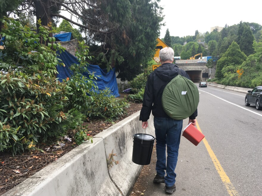 Seattle tech worker Mark Lloyd navigates the city's homeless encampments, giving away toilet kits and connecting with people.