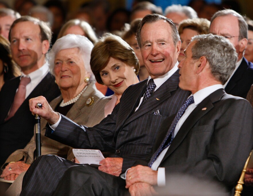 Bush with (from left) his son Neal Bush; wife, Barbara Bush; daughter-in-law Laura Bush; and son former President George W. Bush at a reception in honor of the Points of Light Institute at the White House on  Jan. 7, 2009.