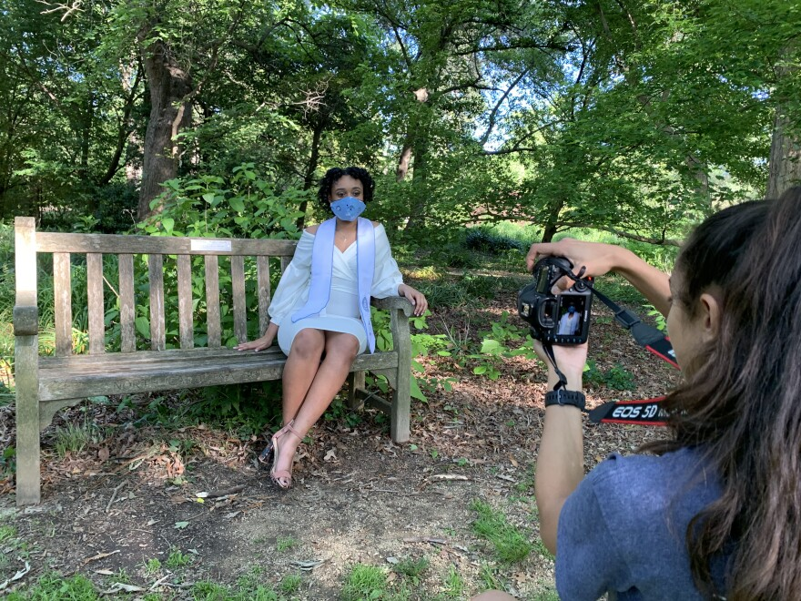 UNC-Chapel Hill graduating senior Amy Martin wears a homemade Carolina facemask during her graduation photoshoot in Coker Arboretum last week.