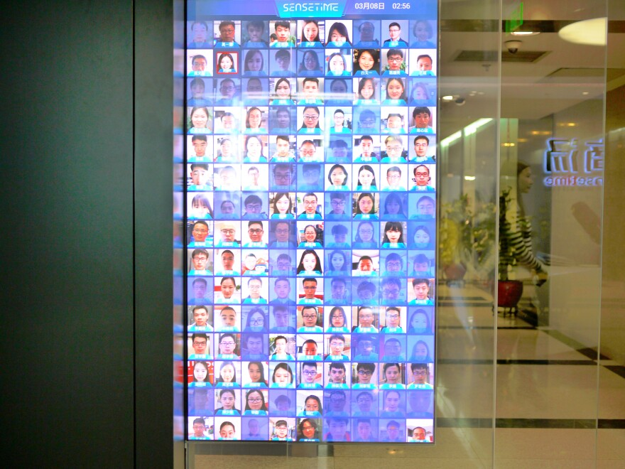 The entrance to SenseTime headquarters in Beijing shows who among the company's employees is inside the office and who is not (faded and tinted blue).