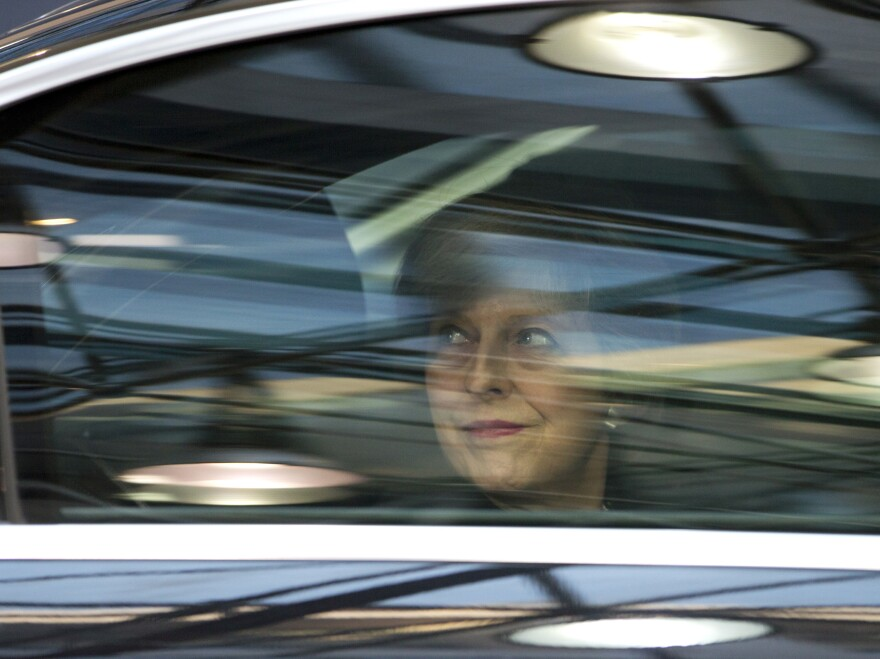 British Prime Minister Theresa May, looks out from her car window as she arrives for an EU Summit in Brussels on Thursday, Dec. 15, 2016.