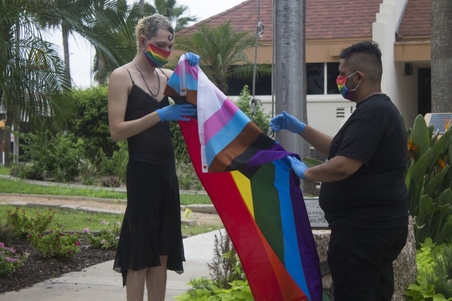 Brownsville residents participate in a LGBTQ+ flag raising ceremony.