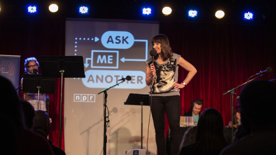 Ophira Eisenberg performs on stage alongside Jonathan Coulton on Ask Me Another at the <em>Bell House</em> in Brooklyn, New York.