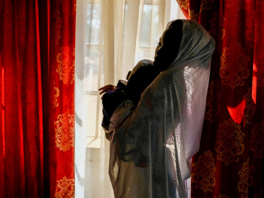Salamatu Umar, who was forced to marry a Boko Haram fighter, holds son Usman Abubakar.