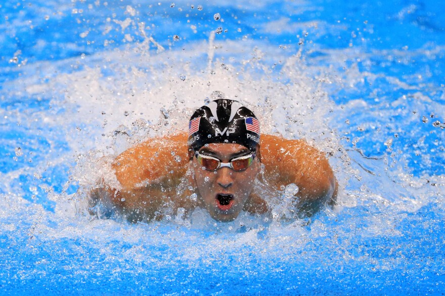 Michael Phelps of the United States competes in the Men's 4 x 100m Medley Relay Final on Thursday.