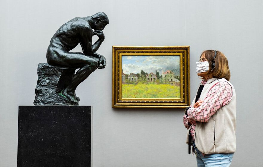 A visitor looks at Rodin's <em>The Thinker</em> at Alte Nationalgalerie in Berlin in May 2020.