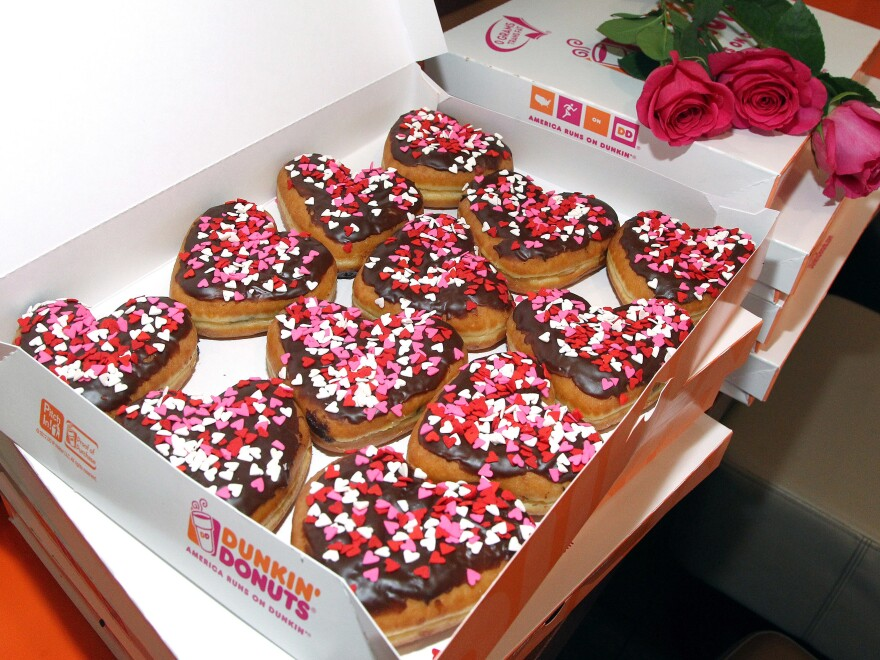 Police officers in Trenton, N.J., won't have to wait until Valentine's Day to feel the love from Dunkin' Donuts. The company is buying the building where the local paper <em></em><em>The Trentonian </em>is headquartered.
