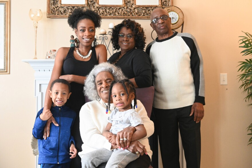 """The Walker family lives together in Florissant. They are (standing from left) Michael """"Amir"""" Nimrod, Andre'a Walker-Nimrod, Wilma Walker, Howard Walker, (seated) matriarch Evelyn Whitfield and Maleeya Nimrod."""