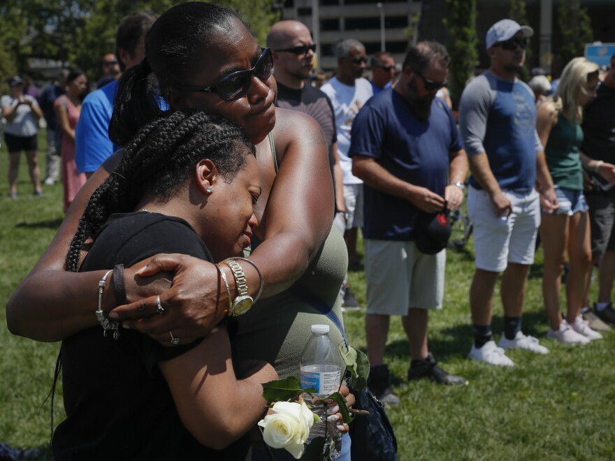 Mourners gather at a vigil following a nearby mass shooting on Sunday in Dayton, Ohio.