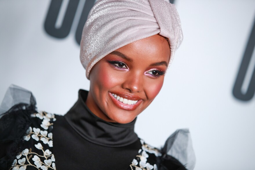 Somali American and Muslim model Halima Aden wears a burkini for <em>Sports Illustrated</em>'s swimsuit issue, sparking both praise and criticism on social media.