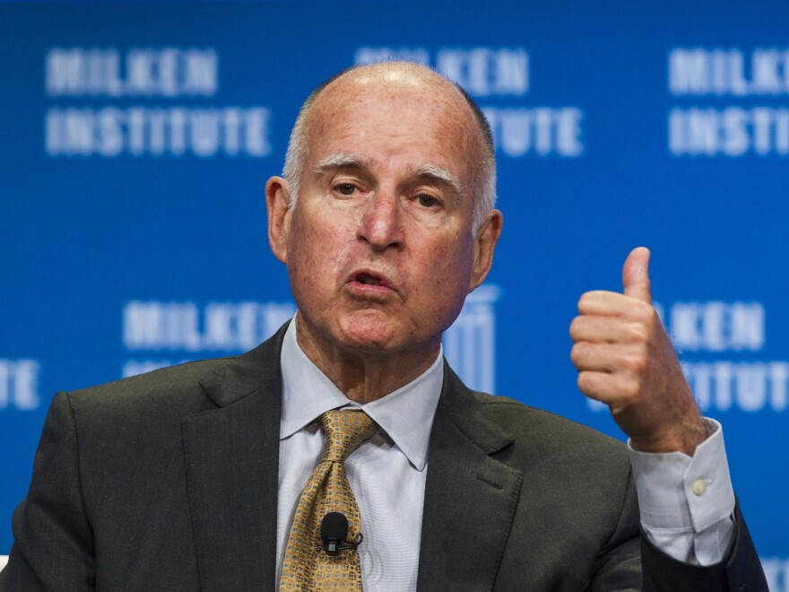 """California Gov. Jerry Brown signed into law the state's  """"motor voter"""" law in hopes of boosting turnout in future elections. The state had 42 percent turnout in the 2014 midterms, a record low."""