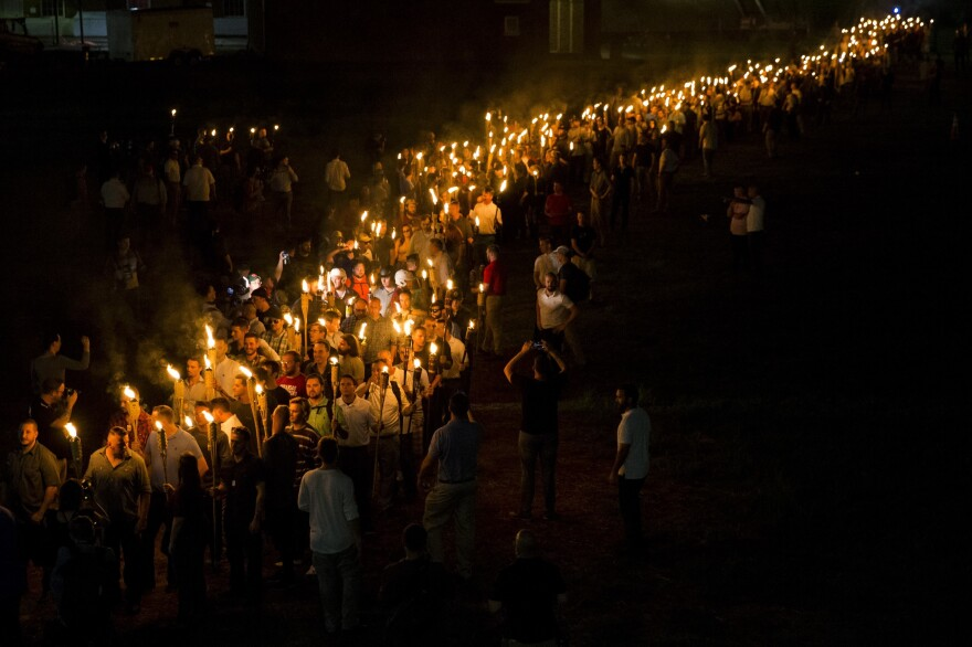 Neo-Nazis, alt-right and white supremacists march through the University of Virginia campus with torches in Charlottesville, Va., on Aug. 11, 2017.