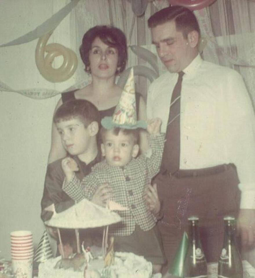 """Blanco, aka """"Little Riqui,"""" celebrates his third birthday with his brother Caco; his mother, Geysa; and his father, Carlos — all dressed in their 1970s best."""