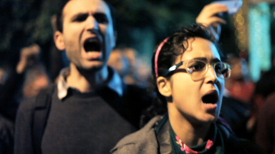 Khalid Abdalla, an activist and actor (<em>The Kite Runner, Green Zone</em> and <em>United 93),</em> and Ahmed Hassan protest in Jehane Noujaim's Oscar-nominated documentary, <em>The Square</em>.