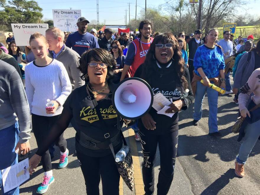 Marchers participate in the MLK March in January 2020.