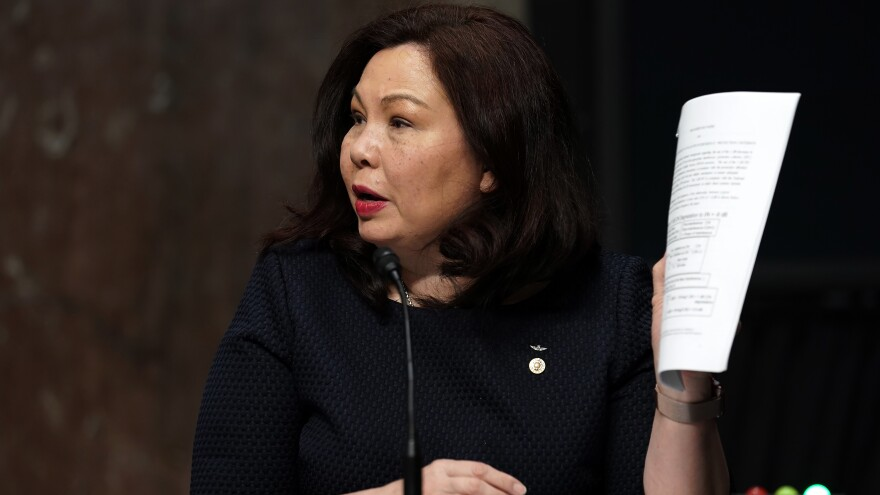 Sen. Tammy Duckworth, D-Ill., at a Senate Armed Services Committee hearing in May. She wants an Army officer who testified at Trump impeachment hearings to get his promotion.