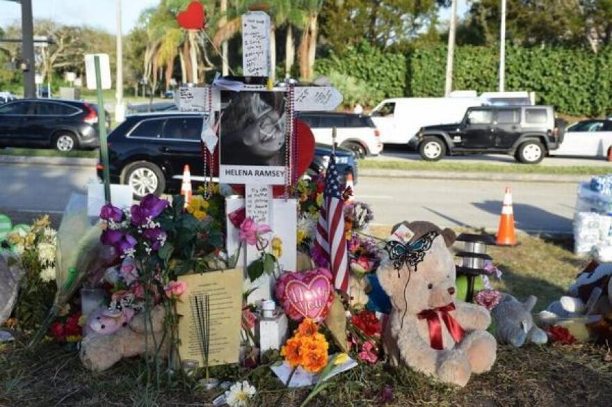 A memorial for Helena Ramsay and the other 16 victims of the Marjory Stoneman Douglas High School is seen at the school. Mourners have left numerous flowers and mementos.
