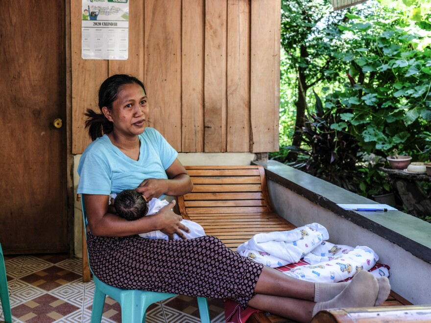 Risa Calibuso breastfeeds her son, Heinrich Claude, in their balcony. He was born on July 27. Calibuso went into labor at home but the local midwife would not participate in a home delivery. Because there were no other options to get Calibuso to the Nueva Vizcaya Provincial Hospital for delivery, the reporter gave her a ride.