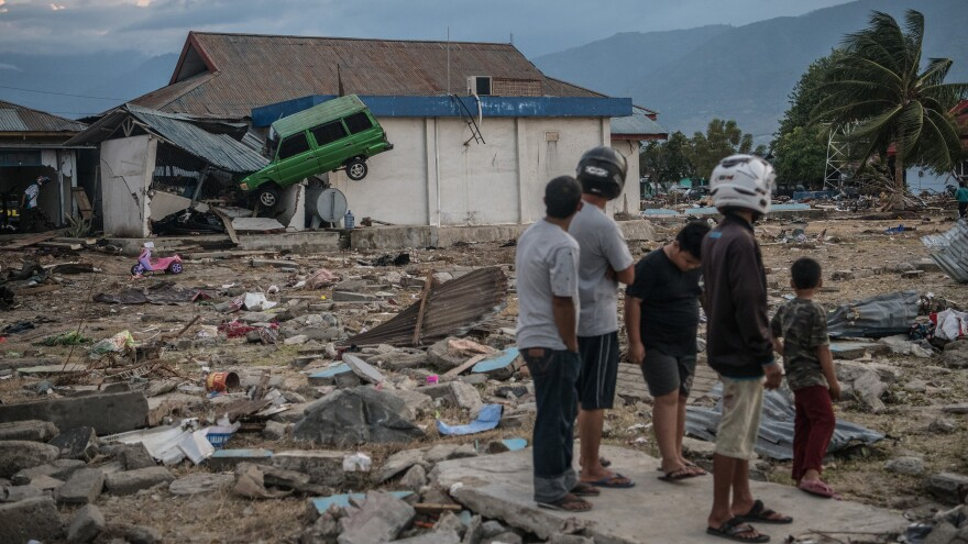 A car sits wedged into a building Monday, days after a tsunami struck the city of Palu, Indonesia, triggered by an earthquake. At least 1,200 people have been confirmed dead in the disaster.