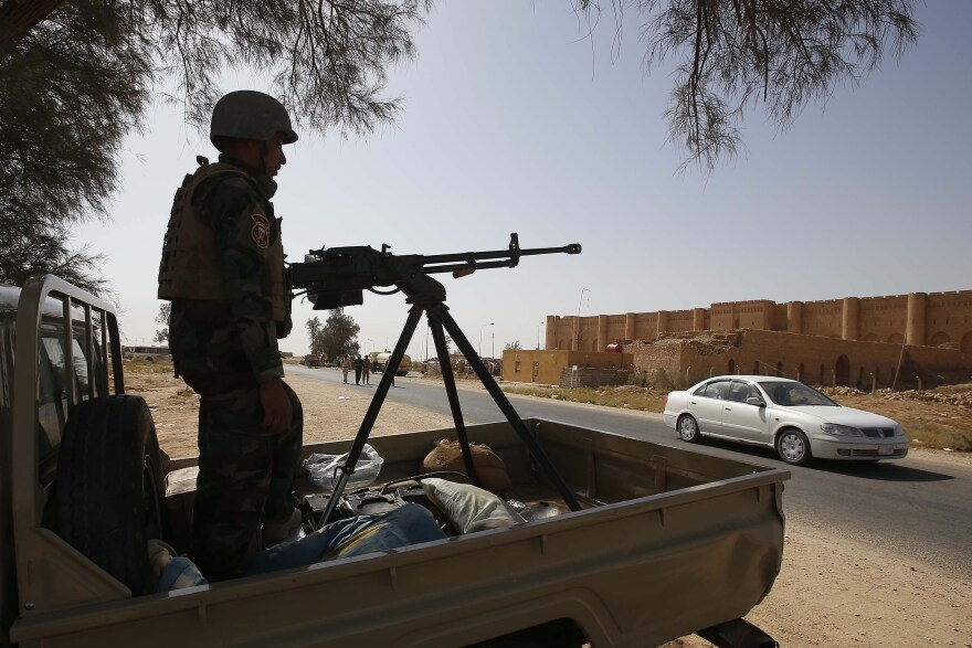 An Iraqi soldier monitors a street west of the shrine city of Karbala, in central Iraq on Sunday.
