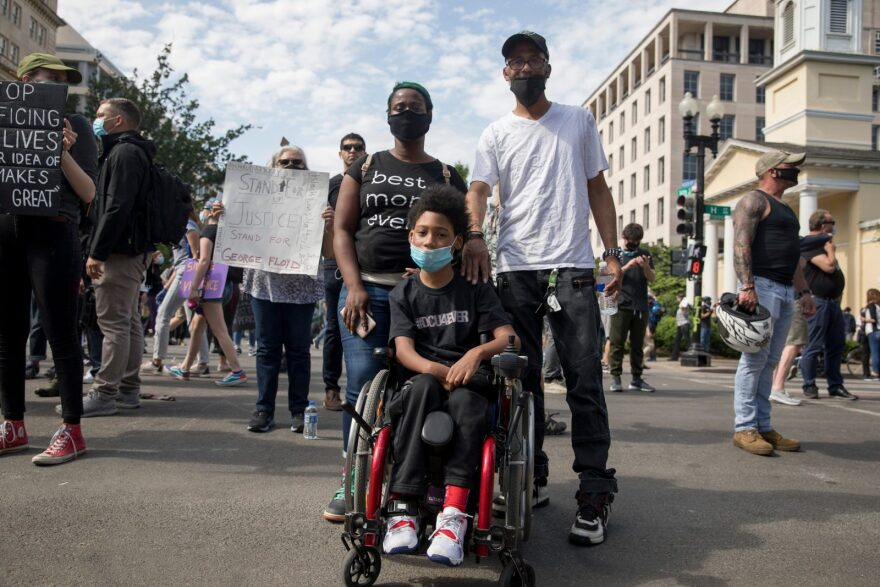 Jeremiah Badgett, 11, of Waldorf, Maryland attends a Black Lives Matter protest with his parents, Jermaine and Danielle Badgett.