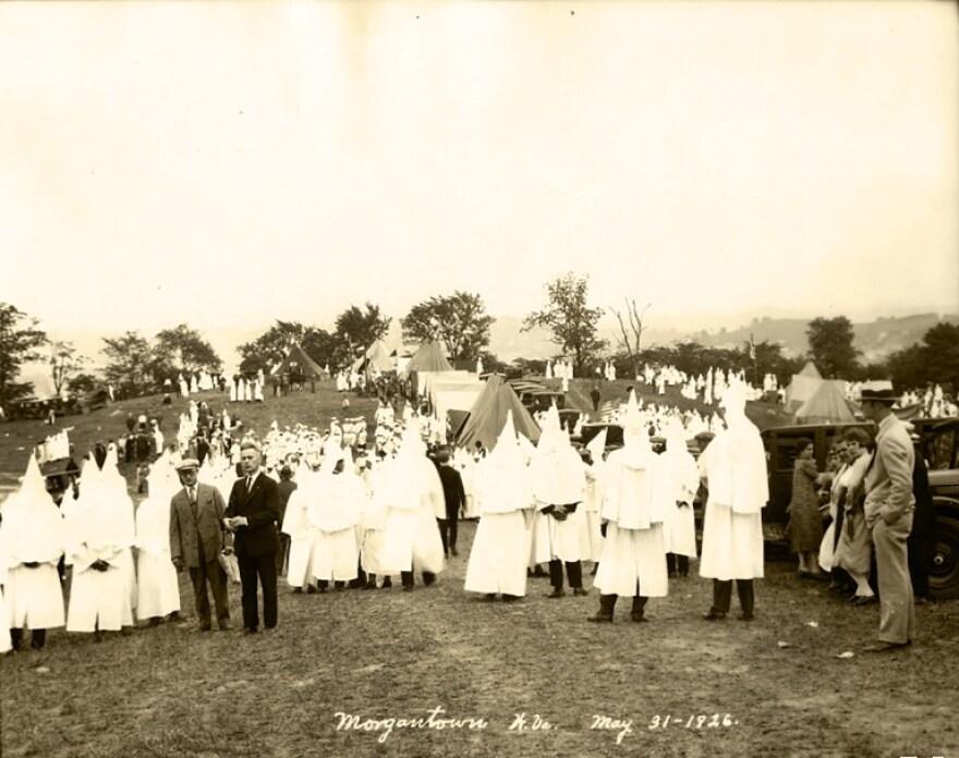 Ku Klux Klan members pose for photos at a camp meeting near Morgantown, W.Va. in May 1926.