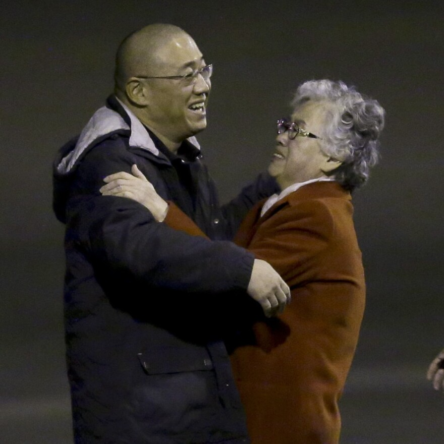 Kenneth Bae greets his mother, Myunghee Bae after arriving Saturday in Washington.