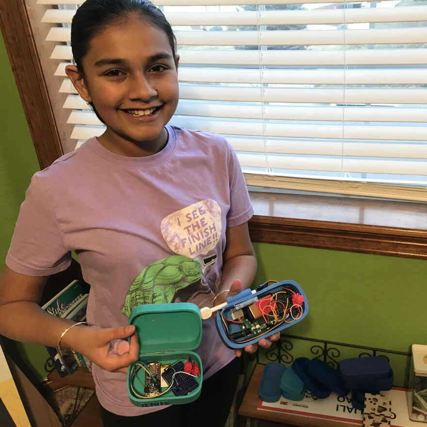 13-year-old Gitanjali Rao with her lead detection device named Tethys. Rao was named America's top young scientist in 2017 and one of Forbes' 30 under 30 in 2019.