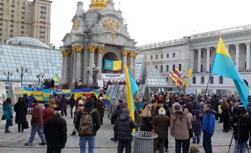 Crowds gather in Maidan at the foot of Kiev's monument to Ukrainian independence.
