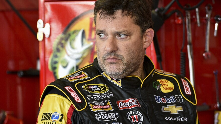 Tony Stewart prepares for a NASCAR Sprint Cup Series race at Watkins Glen, N.Y., in August. Stewart won't face charges in the Aug. 9 death of driver Kevin Ward Jr.