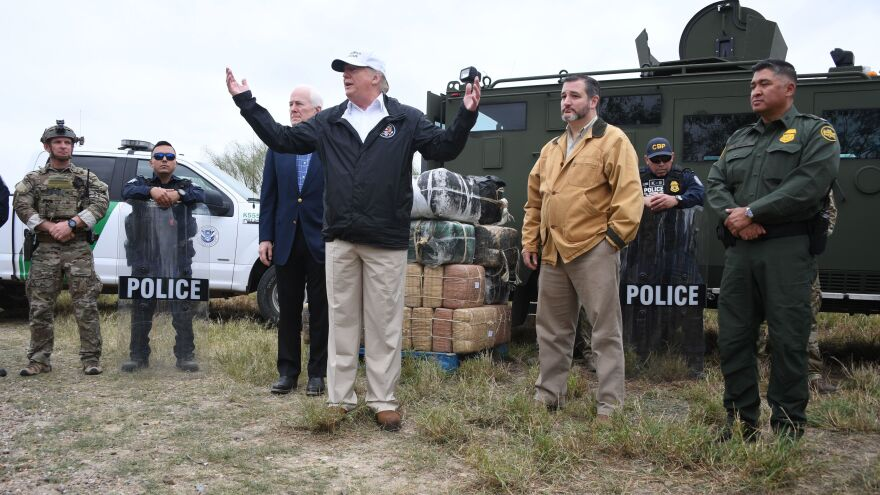 President Trump speaks after he received a briefing on border security next to Texas Republican Sens. John Cornyn (on the left of him) and Ted Cruz (on the right) near the Rio Grande in McAllen, Texas, on Jan. 10.