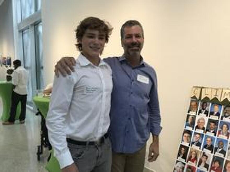 "Jasper Beardslee, left, is a senior at Ransom Everglades School who interned at the CLEO Institute this summer. His dad, Bill Beardslee, says he's proud Jasper's taken childhood lessons on energy conservation and the environment to ""a much higher level."" Jasper spoke at Wednesday night's event."